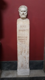 Greek statue- inscription translation: most humans are mean