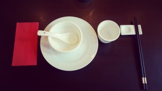 Cup and chinese sticks